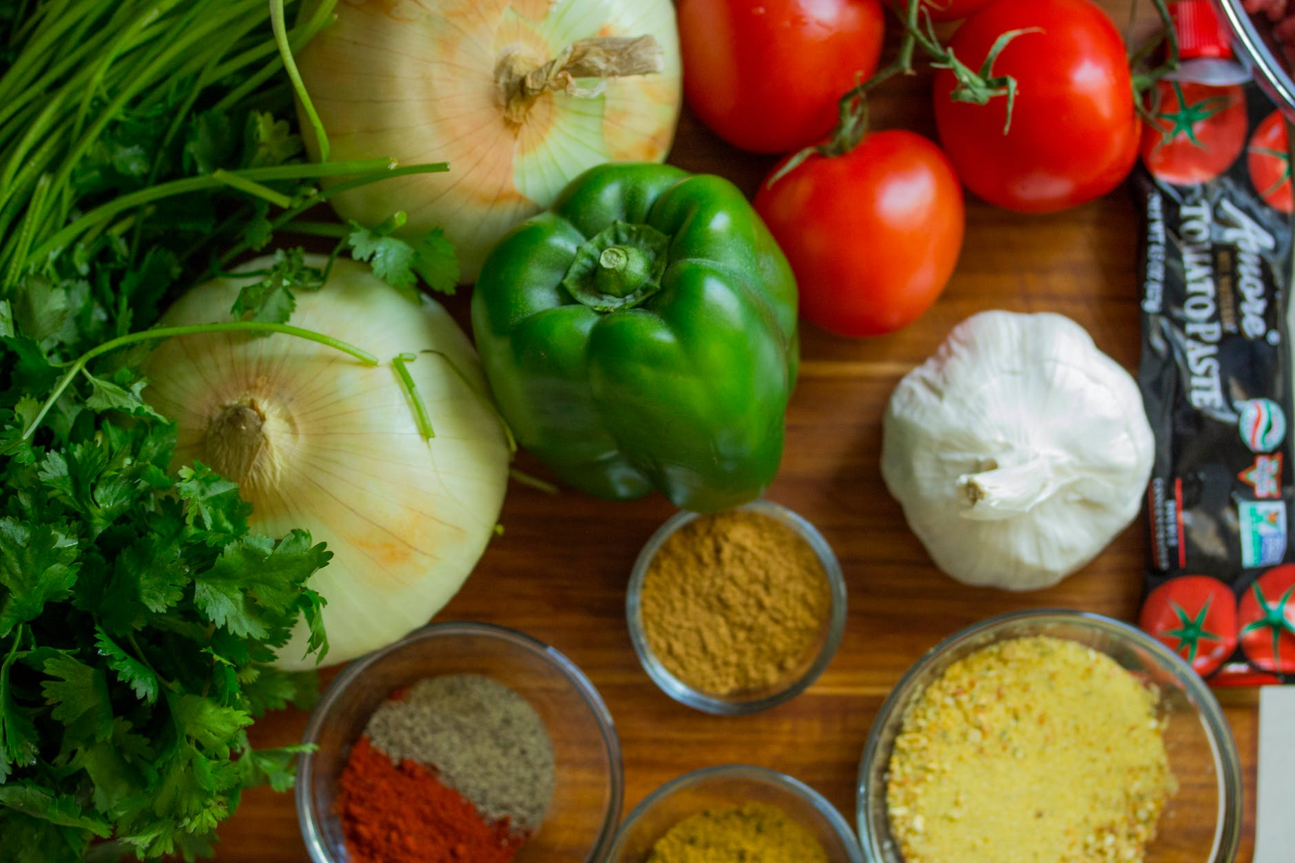 assorted vegetables and spices on wood surface